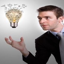 Business man holding light bulb with business concept inside